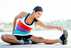 Fit woman stretching Royalty Free Stock Photos