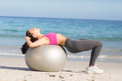 Fit woman stretching on exercise ball Stock Photos