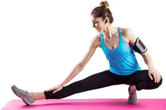Fit woman stretching on exercise mat Royalty Free Stock Photo
