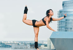 Fit woman stretching Stock Photos