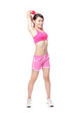 Fit woman stretching her arm Stock Images