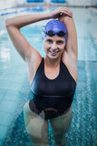 Fit woman stretching her arms in the water Royalty Free Stock Photos