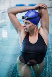 Fit woman stretching her arms in the water Stock Images