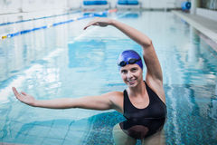 Fit woman stretching her arms in the water Stock Photo