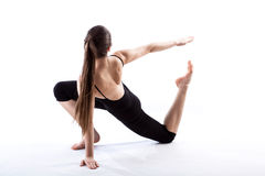 A fit woman stretching her body Stock Photos
