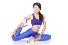 Fit woman stretching her leg to warm up Stock Photo