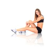 Fit woman stretching her leg to warm up Royalty Free Stock Photography