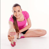 Fit woman stretching her leg to warm up Royalty Free Stock Photo