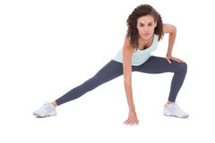 Fit woman stretching her legs Stock Images