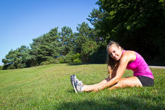Fit woman stretching her muscles before running Stock Image