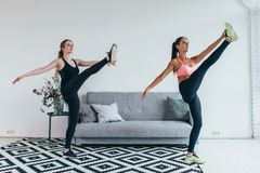 Fit woman stretching legs warming up workout at home Royalty Free Stock Photos