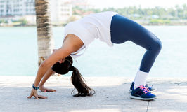 Fit woman stretching outdoors Stock Image