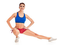 Fit woman stretching and sitting Stock Images