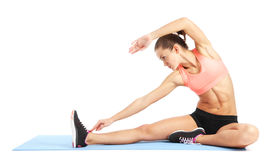 Fit woman stretching to warm up - isolated over white background Stock Images