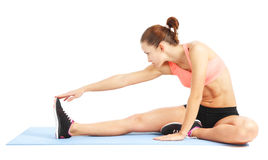 Fit woman stretching to warm up -  over white background Stock Photography