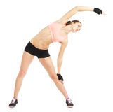 Fit woman stretching to warm up -  over white background Royalty Free Stock Images
