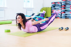 Fit woman stretching training back extension exercise. Fit women stretching training back extension exercise royalty free stock photography