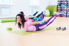 Fit woman stretching training back extension exercise. Royalty Free Stock Photo