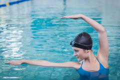 Fit woman stretching in the water Royalty Free Stock Photo