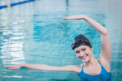 Fit woman stretching in the water Royalty Free Stock Image
