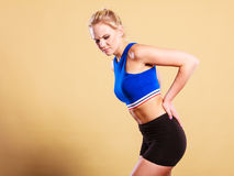 Fit woman suffering from back pain Royalty Free Stock Photography