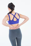 Fit woman suffering from back pain Royalty Free Stock Images