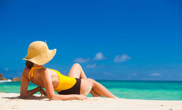 Fit woman in sun hat and bikini at beach.remote tropical beaches and countries. travel concept Stock Images