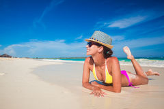 Fit woman in sun hat and bikini at beach Royalty Free Stock Photo