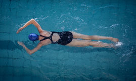 Fit woman swimming in the pool Royalty Free Stock Photography