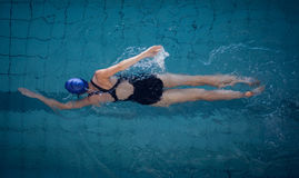 Fit woman swimming in the pool Stock Images