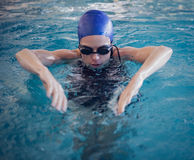 Fit woman swimming in the pool Stock Image