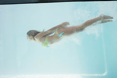 Fit woman swimming under water Royalty Free Stock Photography