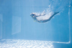 Fit woman swimming under water Stock Images