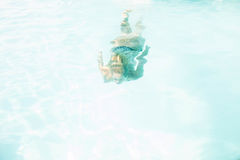 Fit woman swimming under water Stock Image