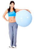 Fit woman with Swiss ball Royalty Free Stock Images