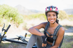 Fit woman taking a break on her bike ride Royalty Free Stock Images