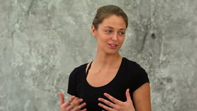 Fit woman talking to her group at yoga class. Close up. Professional shot in 4K resolution. 078. You can use it e.g. in your commercial video, business stock video footage
