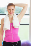 Fit woman with towel around neck at fitness studio Royalty Free Stock Photography