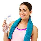 Fit Woman With Towel Drinking Water Royalty Free Stock Photos