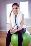 Fit woman with towel and water bottle Stock Image