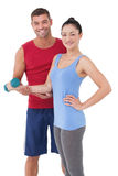 Fit woman and trainer smiling at camera Stock Photo