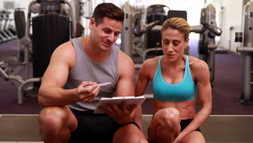 Fit woman and trainer talking about her progress Stock Photos