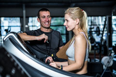 Fit woman with trainer using treadmill Stock Photo