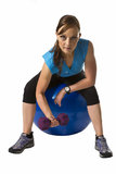 Fit woman training looking at camera on ball Stock Photo