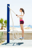 Fit woman training outdoors on a vacation Royalty Free Stock Images