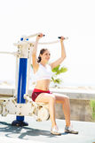 Fit woman training outdoors on a vacation Stock Image