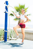 Fit woman training outdoors on a vacation Royalty Free Stock Photo