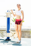 Fit woman training outdoors on a vacation Royalty Free Stock Image