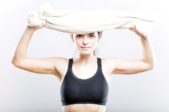 Fit woman after training wiping face with towel Stock Images