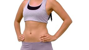 Fit woman turning to camera. On white background in slow motion stock video footage